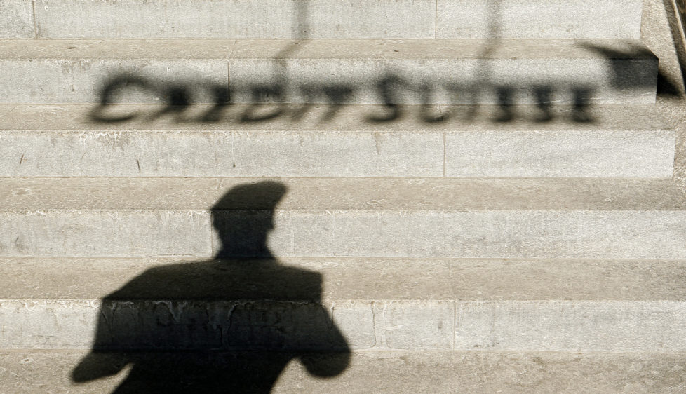 A the shadow of a man and of the logo of Swiss bank Credit Suisse are thrown on stairs in Zurich February 6, 2012. J REUTERS/Arnd Wiegmann (SWITZERLAND - Tags: BUSINESS) - RTR2XEHT