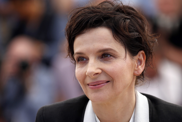 """Cast member Juliette Binoche poses during a photocall for the film """"Sils Maria"""" in competition at the 67th Cannes Film Festival in Cannes"""