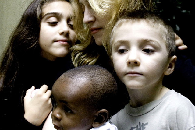 "In this undated handout photo provided by Madonna's publicist Liz Rosenberg, Madonna is shown with her daughter Lourdes, 9, left, son Rocco, 6, right and David Banda, 13-months, who she plans to adopt with her husband director Guy Ritchie. Madonna said that David is healthy and thriving in her London home, in an interview that aired Wednesday, Oct. 25, 2006, on ""The Oprah Winfrey Show."" The child was taken to London last week after Malawi's High Court granted Madonna and her husband, director Guy Ritchie, an interim adoption order. (AP Photo/Shavawn Rissman) ** **"