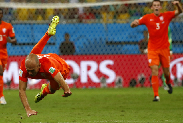 Arjen Robben of the Netherlands is fouled during their 2014 World Cup quarter-finals against Costa Rica at the Fonte Nova arena in Salvador