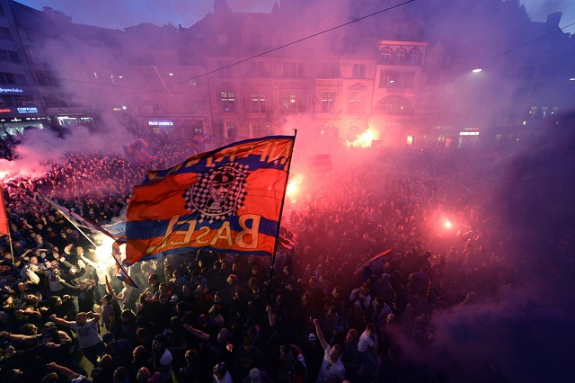 "Fans of FC Basel cheer on the ""Barfuesser-Platz"" square in Basel, Switzerland, after the Super League championship match FC Basel against BSC Young Boys and after winning the championship, Sunday, May 17, 2015. FC Basel won the sixth time in series the Swiss Championships. (KEYSTONE/Georgios Kefalas)"
