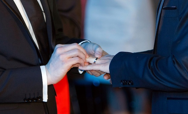 Vincent Autin, left, puts the ring on the finger at Bruno Boileau, during their civil wedding at Montpelier City Hall, Wednesday May 29, 2013. Bruno Boileau, 30, from Paris and Vincent Autin, 40, are the first same-sex couple to marry in France, since French government voted a new law legalizing same-sex marriage.(AP Photo/Claude Paris)