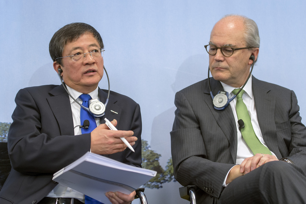Ren Jianxin, Chairman of ChemChina (China National Chemical Corporation), left, and Michel Demare, Chairman of the Board, right, spaek during the annual press conference of agrochemical company Syngenta in Basel on Wednesday, February 3, 2016. Syngenta announced that ChemChina has offered to acquire the company at a value of over US Dollars 43 billion. (KEYSTONE/Georgios Kefalas)