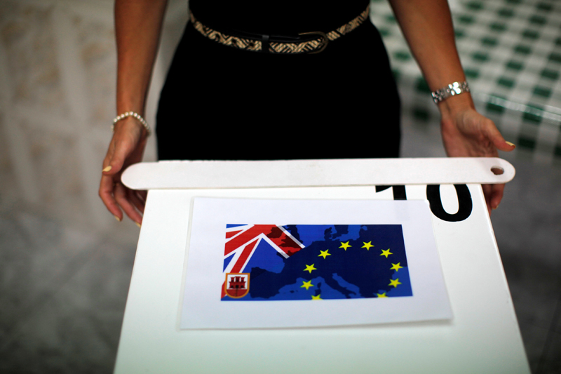 A member of a polling station stands next to a polling box as she waits for citizens during the EU referendum in the British overseas territory of Gibraltar, historically claimed by Spain, June 23, 2016. REUTERS/Jon Nazca - RTX2HSCL