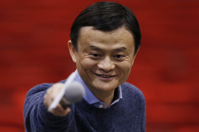 "Alibaba Group Executive Chairman Jack Ma points to a reporter after a speech on ""Transforming Dreams into Successful Business"" to inspire young people to develop their creativity and entrepreneurship by using modern technology in Hong Kong Monday, Feb. 2, 2015. E-commerce giant Alibaba pledged last Friday to do more to fight online sales of counterfeit goods, quickly settling a public dispute with a Chinese regulator after the value of its U.S.-traded shares plunged. (AP Photo/Kin Cheung)"