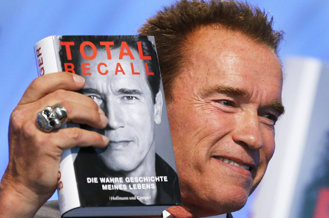 Former state governor of California, Arnold Schwarzenegger displays his book