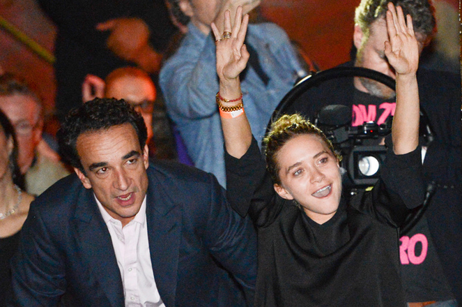 Mary-Kate Olsen and boyfriend Olivier Sarkozy in the audience at The Cutting Room to see Ronnie Wood of the Rolling Stones perform with guitarist Mick Taylor, drummer Simon Kirke and keyboardist Al Cooper on Thursday, Nov. 7, 2013 in New York. (Photo by Evan Agostini/Invision/AP)