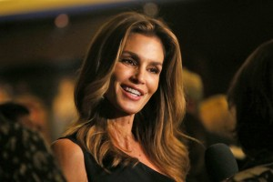 Model Cindy Crawford poses for photographs on arrival at her book launch at the Beaumont Hotel in central London, Thursday, Oct 1, 2015. (Photo by Joel Ryan/Invision/AP)