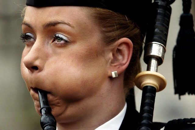 Morven Hammil from Dunbarton, Scotland during the launch of the world pipe band championships in George Square in Glasgow, Tuesday May 25, 2004. Over 8,000 musicians are expected to travel to Glasgow from all over the world to participate. EPA/David Cheskin