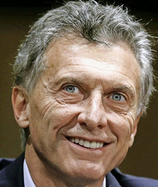 Argentina's president-elect Mauricio Macri smiles during a news conference in Buenos Aires, Argentina, November 23, 2015. Argentines assets rose broadly on Monday after conservative opposition challenger Macri scraped to victory in the presidential election, ending more than a decade of rule under the Peronist movementREUTERS/Enrique Marcarian
