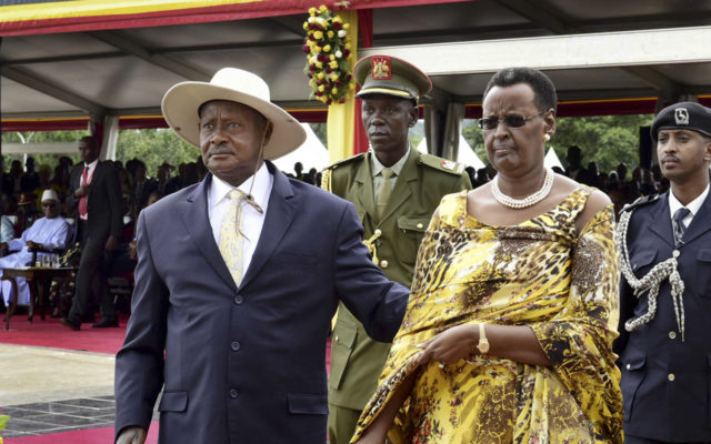 Uganda's long-time president Yoweri Museveni, 71, left, and his wife Janet Museveni, right, attend his inauguration ceremony in the capital Kampala, Uganda Thursday, May 12, 2016. Museveni was sworn in Thursday for a fifth term taking him into his fourth decade in power, amid arrests of opposition politicians and a shutdown of social media. (AP Photo/Stephen Wandera)