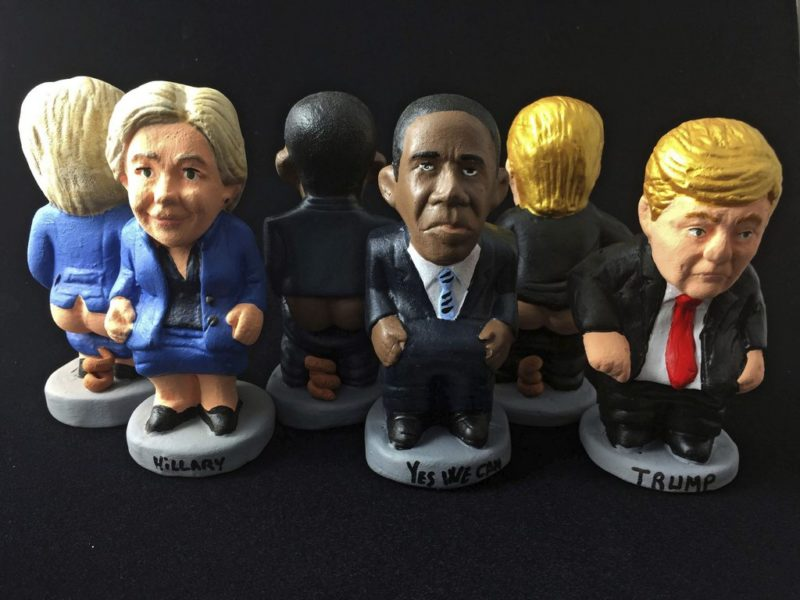 epa05556695 An undated handout picture made avaliable by Caganer.com on 26 September 2016 shows 'caganers' figures of the White House Candidates, Hillary Clinton (L) and Donald Trump (R), and of US President Barack Obama, in Barcelona, Spain. 'Caganers' are representations of people doing their relieves which are placed in the Christmas nativity scenes. The new personalitites choosen as this year's 'caganers' are presented hours before of today's debate in the US. EPA/CAGANER.COM / HANDOUT HANDOUT EDITORIAL USE ONLY/NO SALES