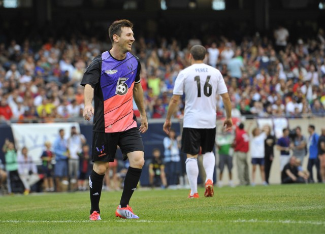 Messi's Friends' Lionel Messi smiles as he stands on the field against the Rest of the World during the first half of the Messi and Friends charity soccer exhibition, Saturday, July 6, 2013 in Chicago. Messi's Friends won 9-6.  (AP Photo/Brian Kersey)