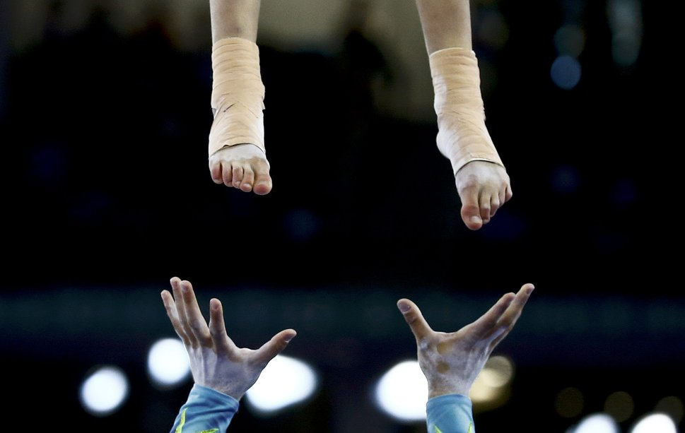 Aleks Zhekov and Elena Velikova of Bulgaria perform during the acrobatic gymnastics mixed pair final at the 1st European Games in Baku, Azerbaijan, June 21 , 2015.      REUTERS/Kai Pfaffenbach TPX IMAGES OF THE DAY