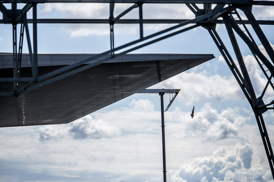 "This handout photo received from Red Bull and taken on June 20, 2015 shows Andy Jones of the USA diving from the 28 metre platform on the Copenhagen Opera House during the fourth stop of the Red Bull Cliff Diving World Series at Copenhagen, Denmark. Gary Hunt of the UK won his fourth straight event of the year to take a commanding lead in the series. AFP PHOTO / HO / RED BULL / Dean TREML ==HANDOUT RESTRICTED TO EDITORIAL USE AND EDITORIAL SALES - MANDATORY CREDIT ""AFP PHOTO / HO / RED BULL / Dean TREML=="