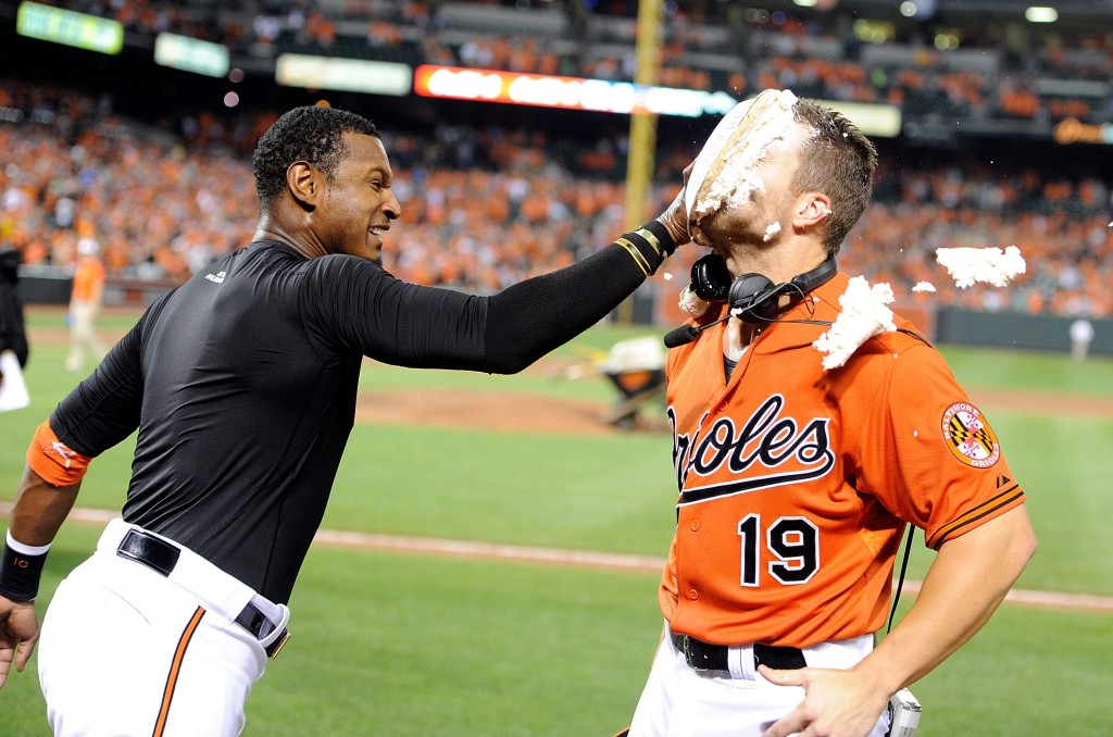 *** BESTPIX *** BALTIMORE, MD - AUGUST 15:  Chris Davis #19 of the Baltimore Orioles is pied by Adam Jones #10 after hitting a walk-off home run in the ninth inning against the Oakland Athletics at Oriole Park at Camden Yards on August 15, 2015 in Baltimore, Maryland. Baltimore won the game 4-3. (Photo by Greg Fiume/Getty Images)