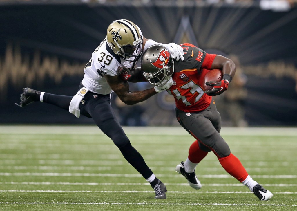 Sep 20, 2015; New Orleans, LA, USA; Tampa Bay Buccaneers running back Bobby Rainey (43) is tackled by New Orleans Saints cornerback Brandon Browner (39) in the second quarter at the Mercedes-Benz Superdome. Mandatory Credit: Chuck Cook-USA TODAY Sports - RTS21H2