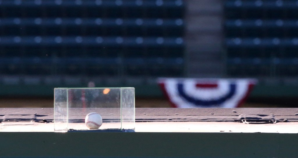 A baseball that was hit for a home run by Chicago Cubs' Kyle Schwarber in the seventh inning in Tuesday's Game 4 of the NLDS sits atop the right field video board at Wrigley Field in Chicago, Wednesday, Oct. 14, 2015. A protective plastic box was placed around the ball by the Cubs organization earlier in the day. (Chris Sweda/Chicago Tribune via AP)
