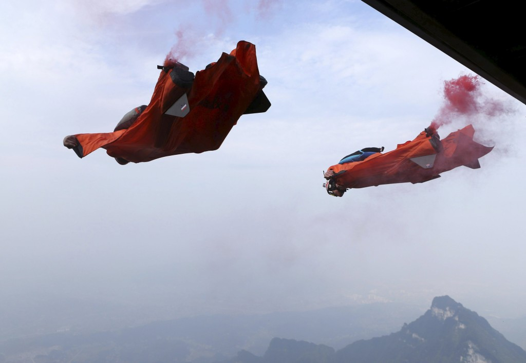 Wingsuit flyer contestants jump off a mountain during the fourth World Wingsuit Flying Tournamentat at the Tianmen Mountain National Park in Zhangjiajie, Hunan province, China, October 18, 2015. Picture taken October 18, 2015. REUTERS/China Daily CHINA OUT. NO COMMERCIAL OR EDITORIAL SALES IN CHINA