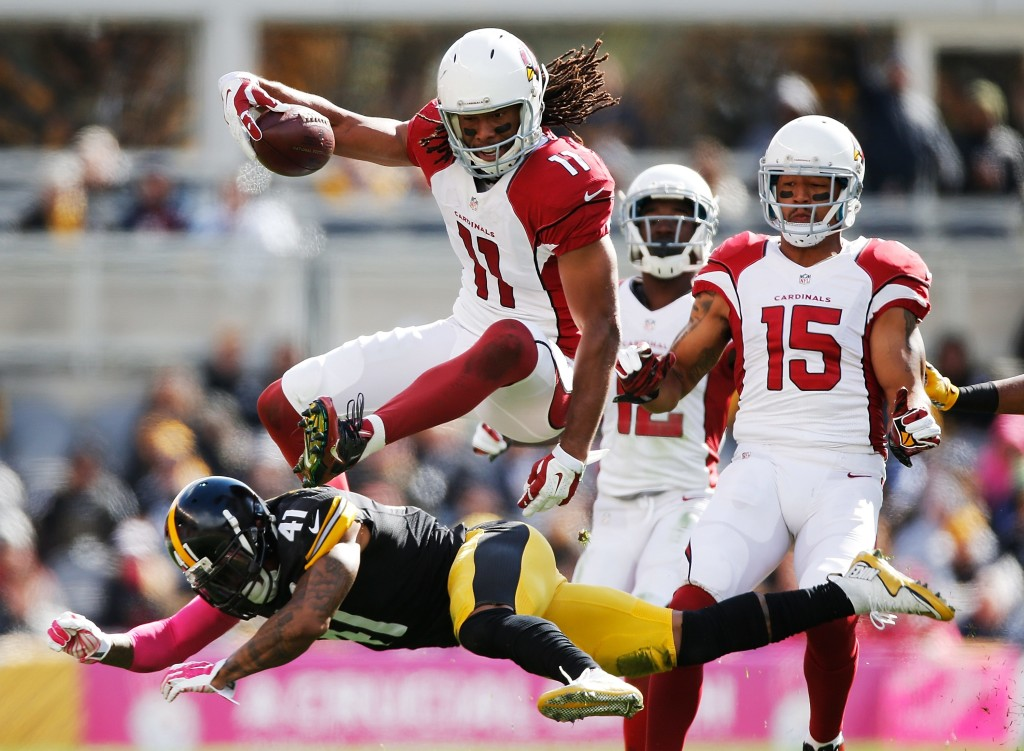 PITTSBURGH, PA - OCTOBER 18: Larry Fitzgerald #11 of the Arizona Cardinals leaps over Antwon Blake #41 of the Pittsburgh Steelers in the 1st half of the gmae at Heinz Field on October 18, 2015 in Pittsburgh, Pennsylvania. (Photo by Gregory Shamus/Getty Images) *** BESTPIX ***