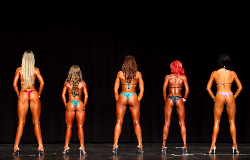 MELBOURNE, AUSTRALIA - OCTOBER 04: Competitors in Bikini First Timers division pose during the Victoria State Bodybuiding Championships on October 4, 2015 at the Kingston Arts Centre in Melbourne, Australia. (Photo by Robert Cianflone/Getty Images)