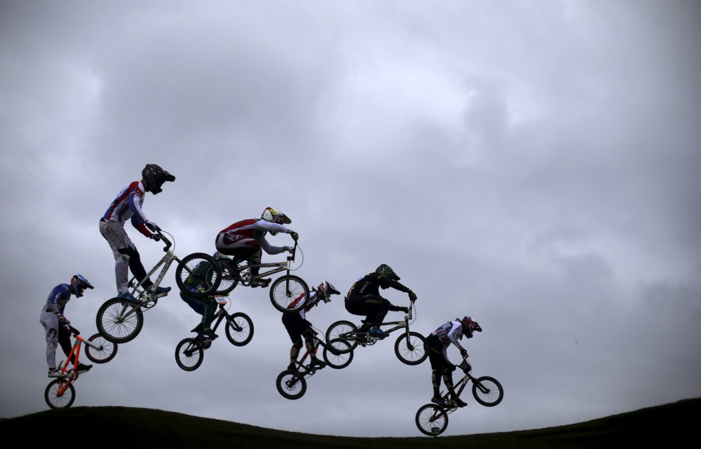 Competitors take part in the International BMX Cycling Challenge at the Rio 2016 Olympic Games BMX cycling track which is part of the X-Park at the Deodoro Sports Complex in Rio de Janeiro, Brazil, October 4, 2015. The International BMX Cycling Challenge is a test event for the Rio 2016 Olympic Games. REUTERS/Ricardo Moraes - RTS2ZW0