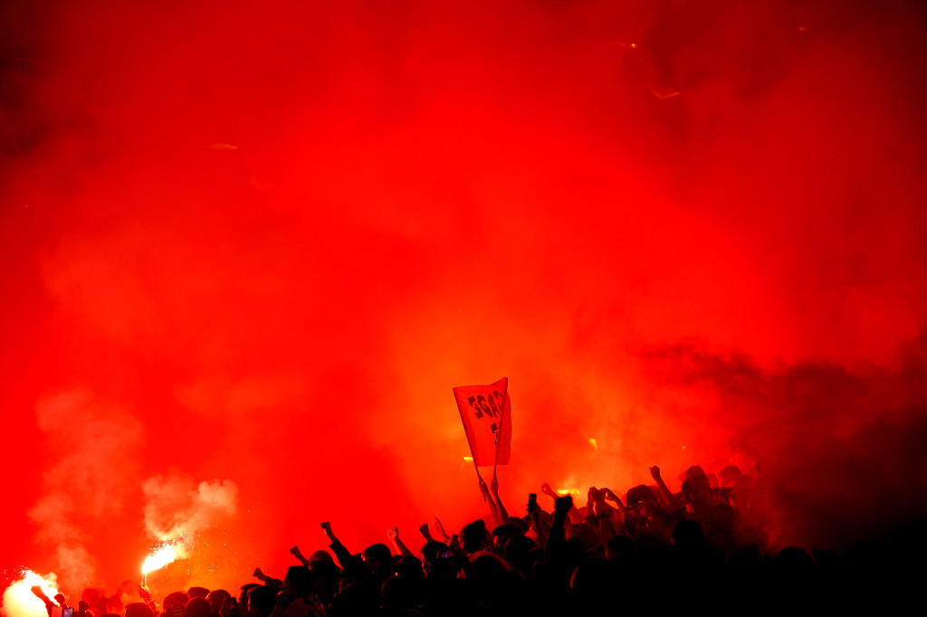Nantes' supporters light flares during the French L1 football match between Nantes and Marseille at the Beaujoire stadium in Nantes, western France, on November 1, 2015. AFP PHOTO / JEAN-SEBASTIEN EVRARD