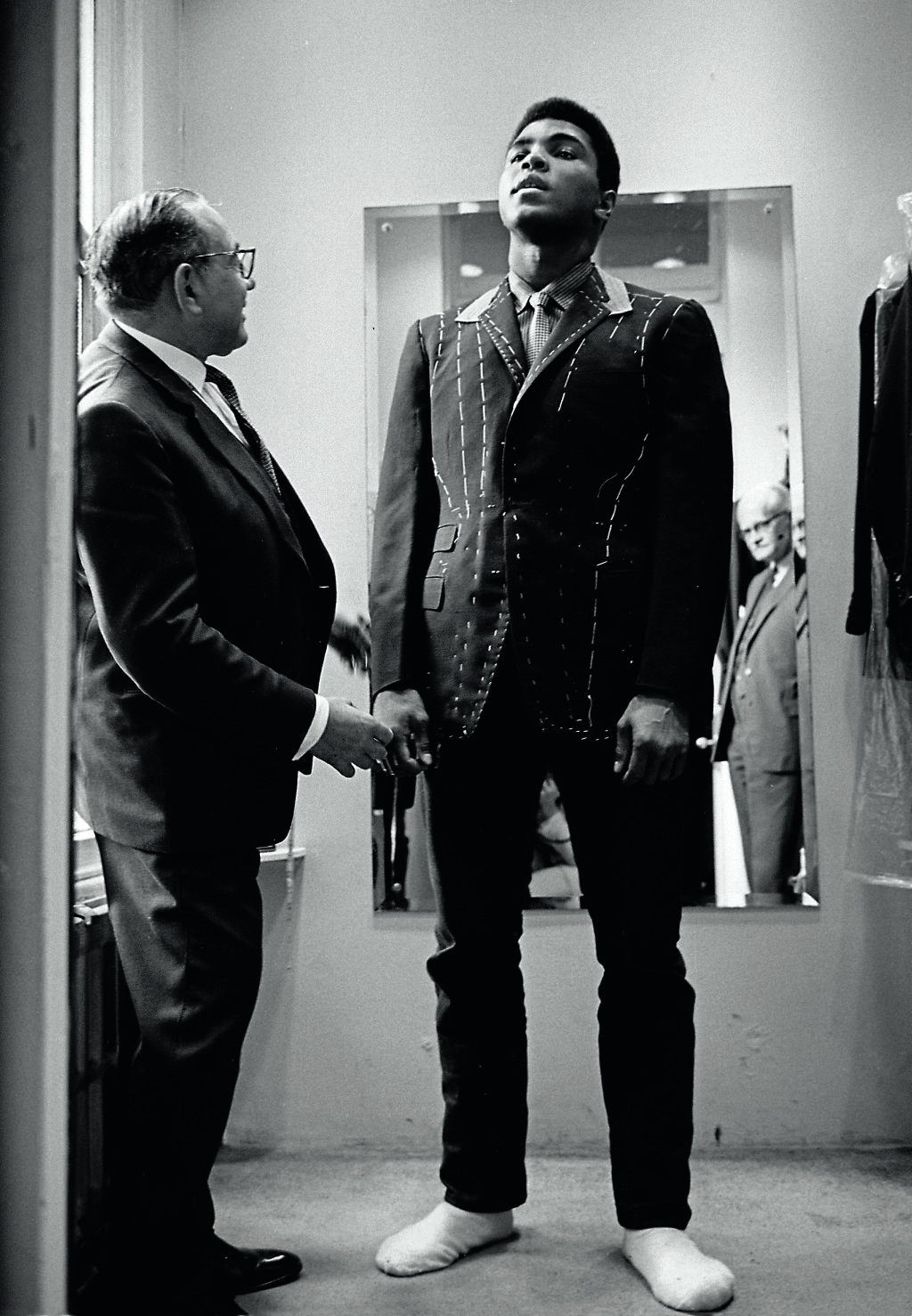 Muhammad Ali (then Cassius Clay), boxing world heavy weight champion at a taylor in London being fitted for a new suit. HOT1966015W02706-8A © Thomas Hoepker / MAGNUM