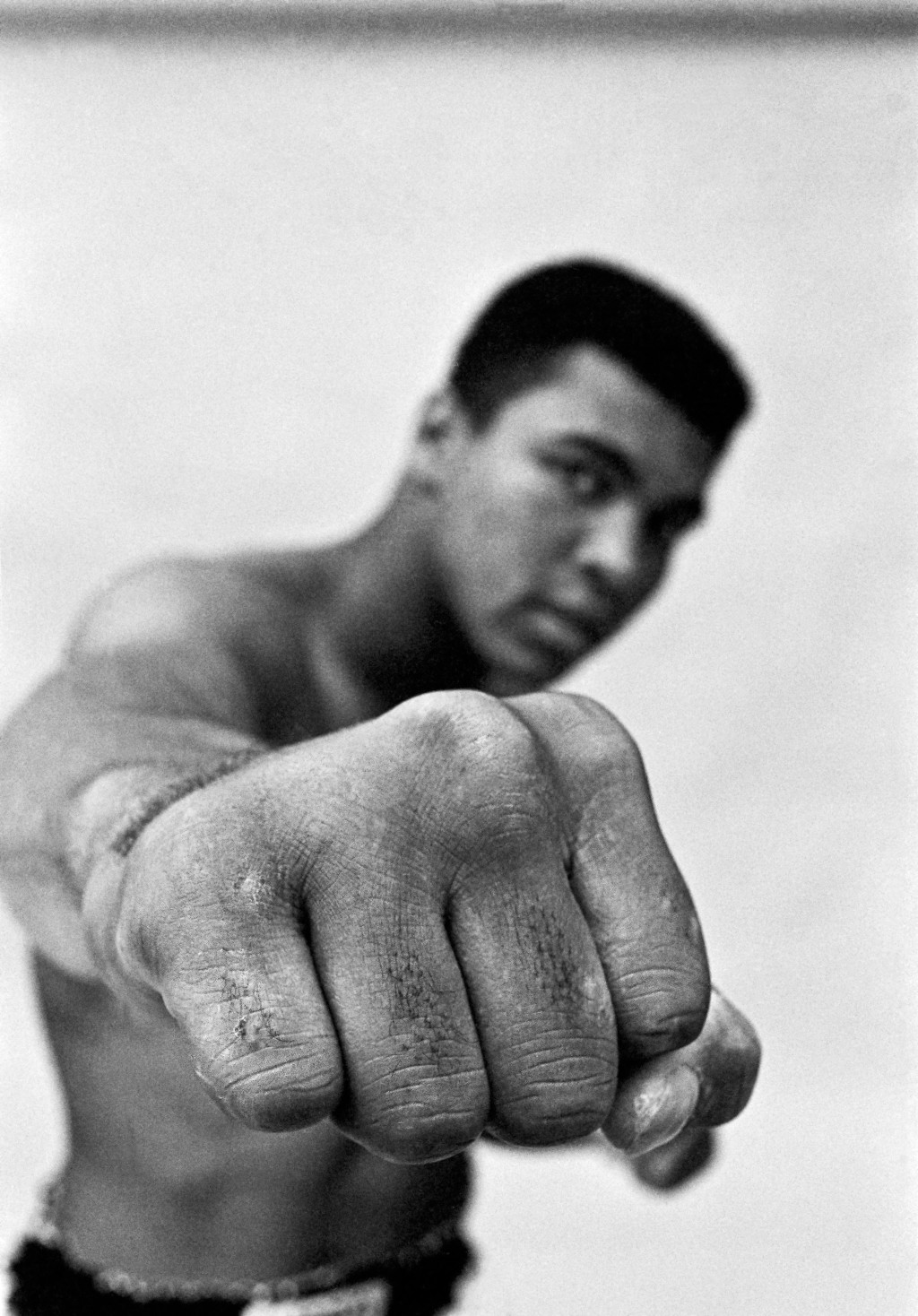 USA. Chicago 1966. MUHAMMAD ALI, boxing world heavy weight champion showing off his right fist.