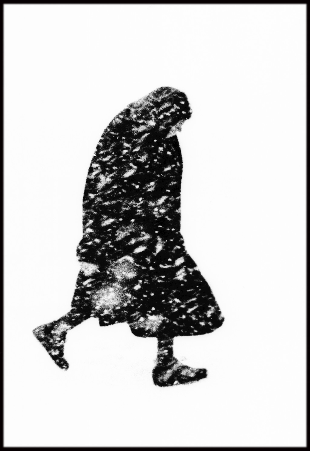 GERMANY, 1954. Hamburg, old woman in a snowstorm.