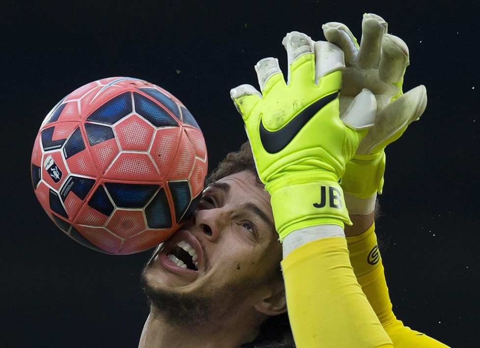 FILE - In this Saturday, Feb. 14, 2015 file photo Blackburn's Rudy Gestede, left, in action against Stoke's goalkeeper Jack Butland during the English FA Cup fifth round soccer match between Blackburn and Stoke at Ewood Park Stadium, Blackburn, England. (AP Photo/Jon Super, file)