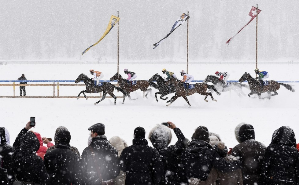 FILE - In this Feb. 15, 2015 file photo eventual winner Fox Kieren rides Berrahri, far left, as he competes during the GP Christoffel Bau Trophy on the frozen Lake St. Moritz on the second weekend of the White Turf races in St. Moritz, Switzerland. (Gian Ehrenzeller/Keystone via AP, file)