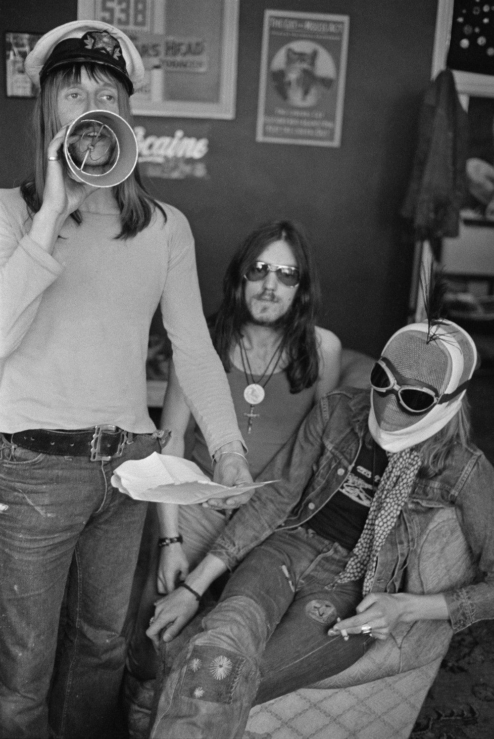 Dave Brock (left) and Ian 'Lemmy' Kilmister, of space rock group Hawkwind, with a masked companion, 17th May 1973. (Photo by Michael Putland/Getty Images)
