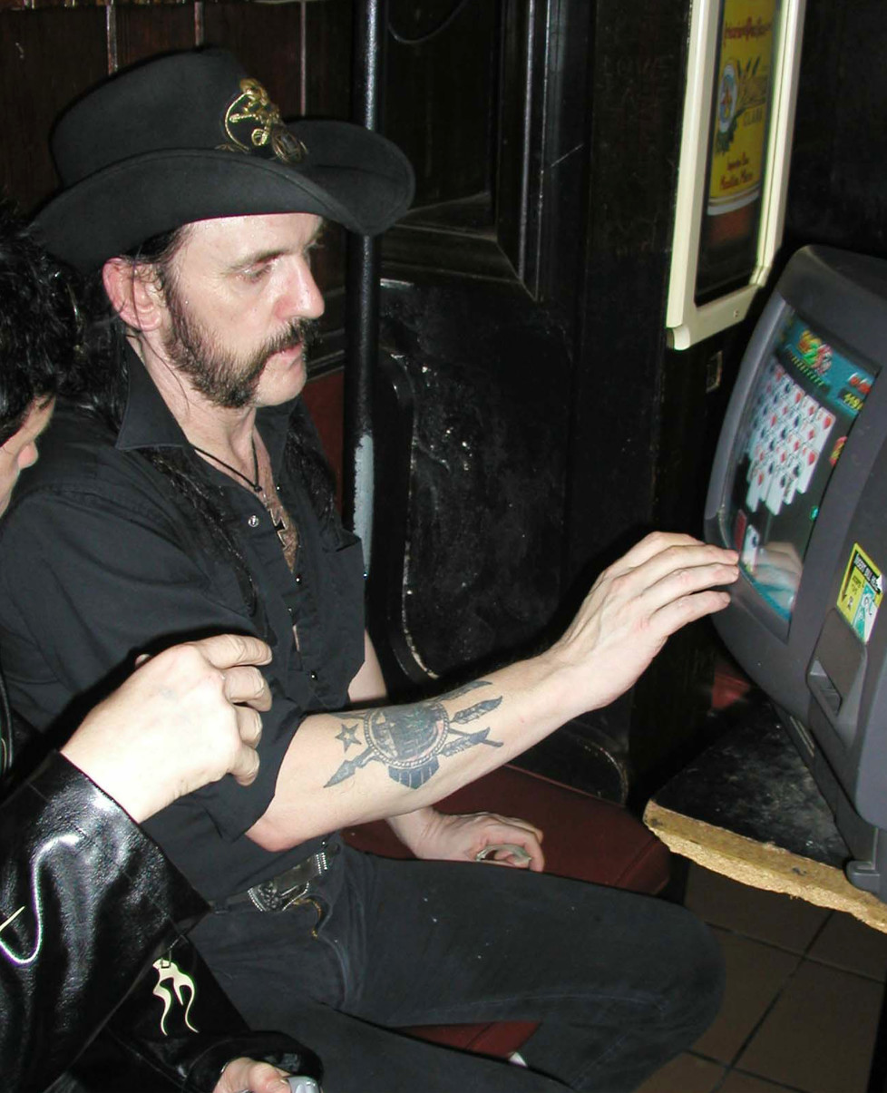 WEST HOLLYWOOD - CA: Motorhead singer Lemmy Kilmister plays video poker at the Rainbow Bar & Grill, September 2, 2003 in West Hollywood California. (Photo by Alexander Sibaja/Getty Images)