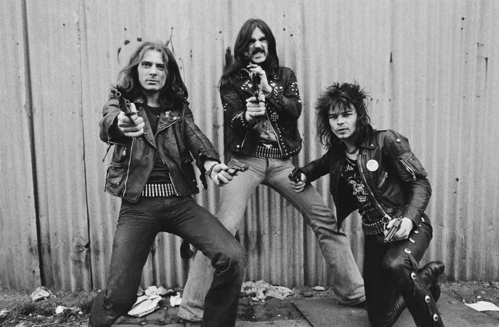 British heavy rock band Motorhead pose with pistols, London, 1978. Left to right: guitarist 'Fast' Eddie Clarke, bassist and singer Lemmy (Ian Kilmister) and drummer Phil 'Philthy Animal' Taylor. (Photo by Estate Of Keith Morris/Redferns)