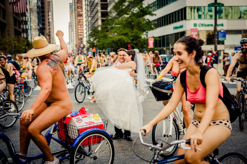 **MANDATORY PICTURE CREDIT** PIC BY: JPG PHOTOGRAPHY / ISPWP / CATERS NEWS (Pictured: Naked bike ride messes up couples wedding photo) - These hilarious photos will leave people WEDDING themselves with laughter. The images - which include photobombs, wardrobe malfunctions and unexpected animal behaviour - have been released by the International Society of Professional Wedding Photographs (ISPWP). Each year the society holds quarterly competitions, celebrating a variety of the best image from couples special days. Other categories in the ISPWPs completions include the likes Getting Ready, First Dance, Family Love, and a selection of portrait possibilities. - SEE CATERS COPY (FOTO: DUKAS/CATERSNEWS) *** Local Caption *** Funniest Wedding Photos of 2015