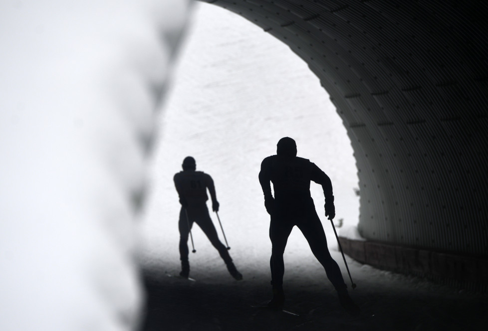 Skiers compete in the men's 15 km Individual free event of the FIS Cross-Country World Cup on January 23, 2016 in Nove Mesto na Morave. / AFP / Michal Cizek