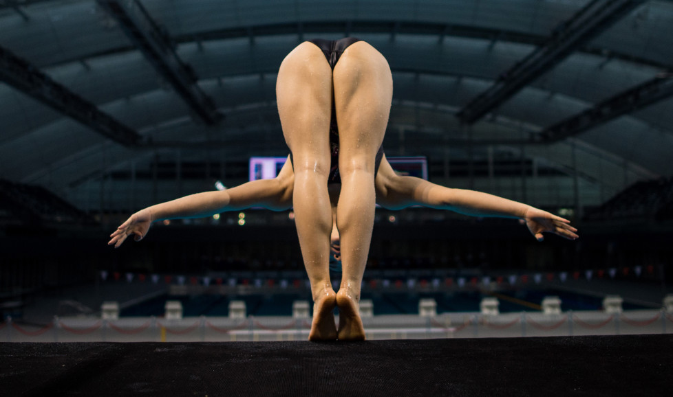 This photo taken on January 20, 2016 in Shanghai shows a member of the Chinese national Diving team jumping of the 10m platform during a training session in the Oriental Sports Center. / AFP / JOHANNES EISELE