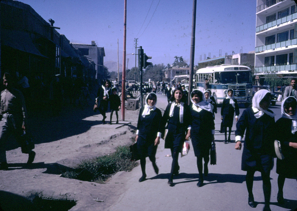 """""""Afghan girls coming home from school. """"Afghan girls, as well as boys, were educated up to the high school level, and although girls (and boys) wore uniforms, the girls were not allowed to wear a chadri on their way to secondary school. Able young women attended college, as did the men."""" - Peg Podlich"""""""