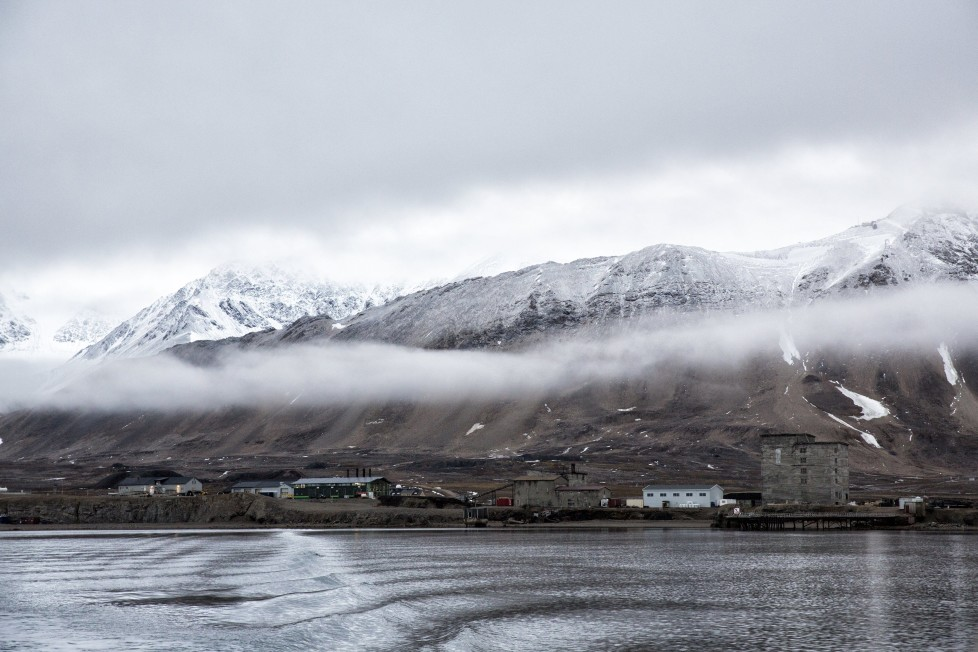 "Low clouds are seen in the Kings Bay of Ny-Alesund, Svalbard, Norway, October 12, 2015. A Norwegian chain of islands just 1,200 km (750 miles) from the North Pole is trying to promote new technologies, tourism and scientific research in a shift from high-polluting coal mining that has been a backbone of the remote economy for decades. Norway suspended most coal mining on the Svalbard archipelago last year because of the high costs, and is looking for alternative jobs for about 2,200 inhabitants on islands where polar bears roam. Part of the answer may be to boost science: in Ny-Alesund, the world's most northerly permanent non-military settlement, scientists from 11 nations including Norway, Germany, France, Britain, India and South Korea study issues such as climate change. The presence of Norway, a NATO member, also gives the alliance a strategic foothold in the far north, of increasing importance after neighbouring Russia annexed Ukraine's Crimea region in 2014. REUTERS/Anna FilipovaPICTURE 19 OF 19 - SEARCH ""SVALBARD FILIPOVA"" FOR ALL IMAGES"