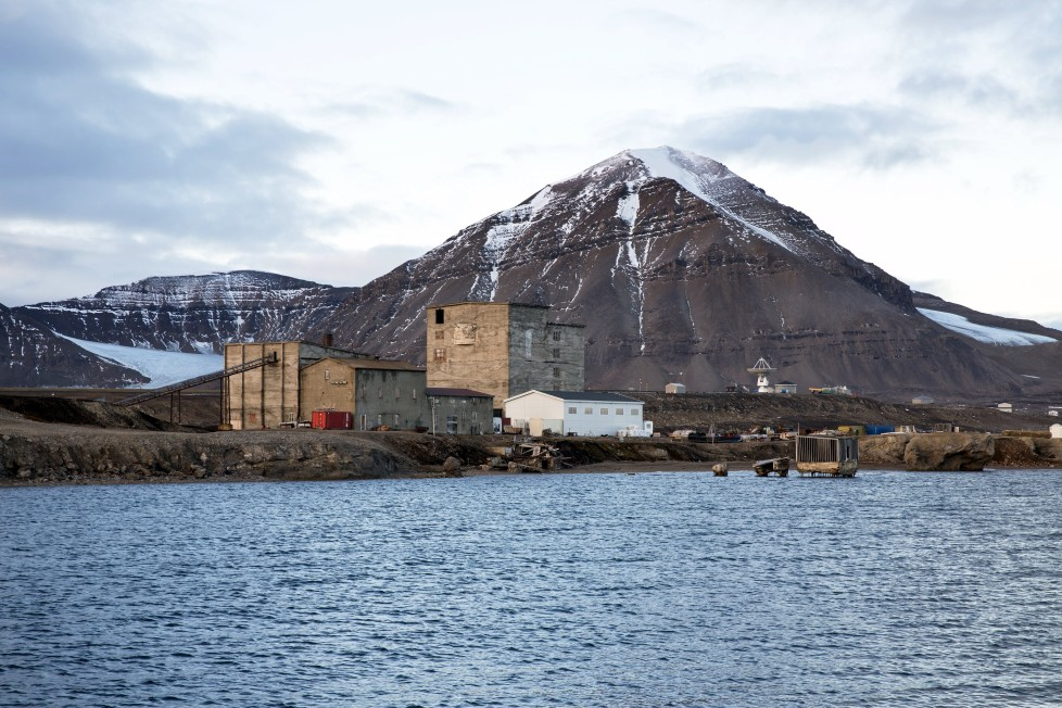 "Warehouses and the old part of the Ny-Alesund, Norway settlement from the coal mining period which closed in 1963, are seen October 11, 2015. A Norwegian chain of islands just 1,200 km (750 miles) from the North Pole is trying to promote new technologies, tourism and scientific research in a shift from high-polluting coal mining that has been a backbone of the remote economy for decades. Norway suspended most coal mining on the Svalbard archipelago last year because of the high costs, and is looking for alternative jobs for about 2,200 inhabitants on islands where polar bears roam. Part of the answer may be to boost science: in Ny-Alesund, the world's most northerly permanent non-military settlement, scientists from 11 nations including Norway, Germany, France, Britain, India and South Korea study issues such as climate change. The presence of Norway, a NATO member, also gives the alliance a strategic foothold in the far north, of increasing importance after neighbouring Russia annexed Ukraine's Crimea region in 2014. REUTERS/Anna FilipovaPICTURE 15 OF 19 - SEARCH ""SVALBARD FILIPOVA"" FOR ALL IMAGES"