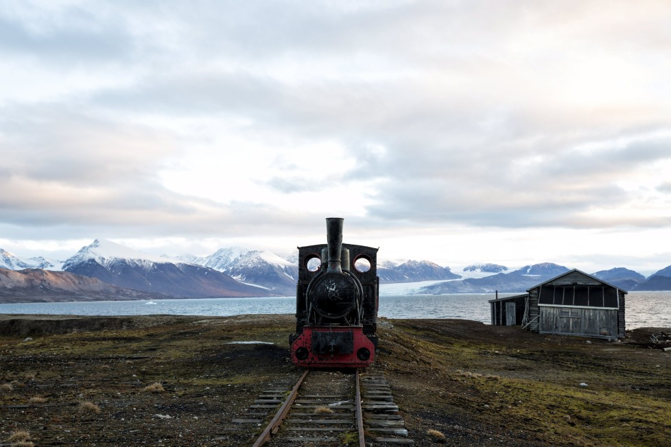 An old locomotive train that was used for transporting coal is preserved as a monument at Ny-Alesund, in Svalbard, Norway, October 11, 2015. A Norwegian chain of islands just 1,200 km (750 miles) from the North Pole is trying to promote new technologies, tourism and scientific research in a shift from high-polluting coal mining that has been a backbone of the remote economy for decades. Norway suspended most coal mining on the Svalbard archipelago last year because of the high costs, and is looking for alternative jobs for about 2,200 inhabitants on islands where polar bears roam. Part of the answer may be to boost science: in Ny-Alesund, the world's most northerly permanent non-military settlement, scientists from 11 nations including Norway, Germany, France, Britain, India and South Korea study issues such as climate change. The presence of Norway, a NATO member, also gives the alliance a strategic foothold in the far north, of increasing importance after neighbouring Russia annexed Ukraine's Crimea region in 2014. REUTERS/Anna Filipova