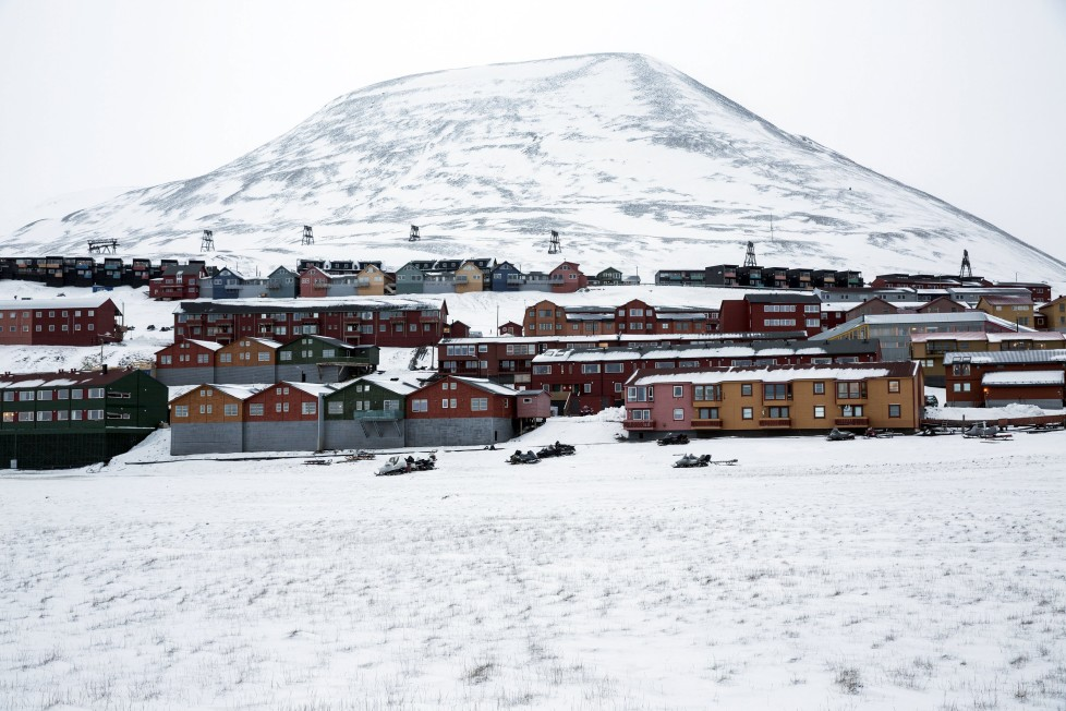 "Workers housing of Longyerbyean, Svalbard are seen covered in snow October 23, 2015. A Norwegian chain of islands just 1,200 km (750 miles) from the North Pole is trying to promote new technologies, tourism and scientific research in a shift from high-polluting coal mining that has been a backbone of the remote economy for decades. Norway suspended most coal mining on the Svalbard archipelago last year because of the high costs, and is looking for alternative jobs for about 2,200 inhabitants on islands where polar bears roam. Part of the answer may be to boost science: in Ny-Alesund, the world's most northerly permanent non-military settlement, scientists from 11 nations including Norway, Germany, France, Britain, India and South Korea study issues such as climate change. The presence of Norway, a NATO member, also gives the alliance a strategic foothold in the far north, of increasing importance after neighbouring Russia annexed Ukraine's Crimea region in 2014. REUTERS/Anna Filipova TPX IMAGES OF THE DAYPICTURE 05 OF 19 - SEARCH ""SVALBARD FILIPOVA"" FOR ALL IMAGES"