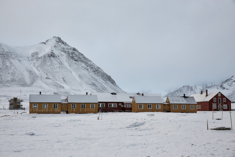 "Snow is seen on the research centre, formerly a coal mining town, in Ny-Alesund, Svalbard, Norway October 13, 2015. A Norwegian chain of islands just 1,200 km (750 miles) from the North Pole is trying to promote new technologies, tourism and scientific research in a shift from high-polluting coal mining that has been a backbone of the remote economy for decades. Norway suspended most coal mining on the Svalbard archipelago last year because of the high costs, and is looking for alternative jobs for about 2,200 inhabitants on islands where polar bears roam. Part of the answer may be to boost science: in Ny-Alesund, the world's most northerly permanent non-military settlement, scientists from 11 nations including Norway, Germany, France, Britain, India and South Korea study issues such as climate change. The presence of Norway, a NATO member, also gives the alliance a strategic foothold in the far north, of increasing importance after neighbouring Russia annexed Ukraine's Crimea region in 2014. REUTERS/Anna FilipovaPICTURE 04 OF 19 - SEARCH ""SVALBARD FILIPOVA"" FOR ALL IMAGES"