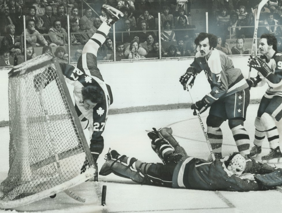 CANADA - DECEMBER 01: Scoring With A Flair: Leafs' Darryl Sittler (27) turns a somersault and knocks goal posts off supports after scoring one of two goals in Saturday night's game against Washington Capitals at the Gardens. Caps' goalie Ron Low is sprawled along ice while teammate Yvon Labre (7) looks on with dismay and Leafs' Norm Ullman seems surprised by Sittler's tumble. Sittler was unhurt as Leafs went on to 7-1 win. Toronto game last night in Detroit was snowed out. (Photo by Ron Bull/Toronto Star via Getty Images)