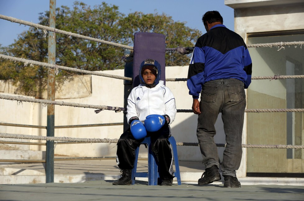 "REFILE - CLARIFYING NAME OF BOXING CLUBAamna, 11, waits for the start for her bout during the Sindh Junior Sports Association Boxing Tournament in Karachi, Pakistan February 21, 2016. For the past six months about a dozen girls, aged 8 to 17, have gone to the Pak Shaheen Boxing Club after school to practice their jabs, hooks and upper cuts. Pakistani women have been training as boxers in small numbers and competed in the South Asian Games last year, said Younis Qambrani, the coach who founded the club in 1992 in the Karachi neighbourhood of Lyari, better known for internecine gang warfare than for breaking glass ceilings. REUTERS/Akhtar Soomro SEARCH ""THE WIDER IMAGE"" FOR ALL STORIES"