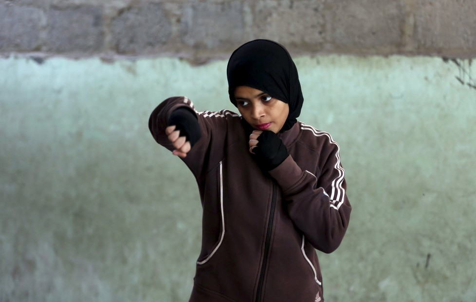 "REFILE - CLARIFYING NAME OF BOXING CLUBMisbah, 17, takes part in warm up exercises at the first women's boxing coaching camp in Karachi, Pakistan February 19, 2016. For the past six months about a dozen girls, aged 8 to 17, have gone to the Pak Shaheen Boxing Club after school to practice their jabs, hooks and upper cuts. Pakistani women have been training as boxers in small numbers and competed in the South Asian Games last year, said Younis Qambrani, the coach who founded the club in 1992 in the Karachi neighbourhood of Lyari, better known for internecine gang warfare than for breaking glass ceilings. REUTERS/Akhtar Soomro SEARCH ""THE WIDER IMAGE"" FOR ALL STORIES"