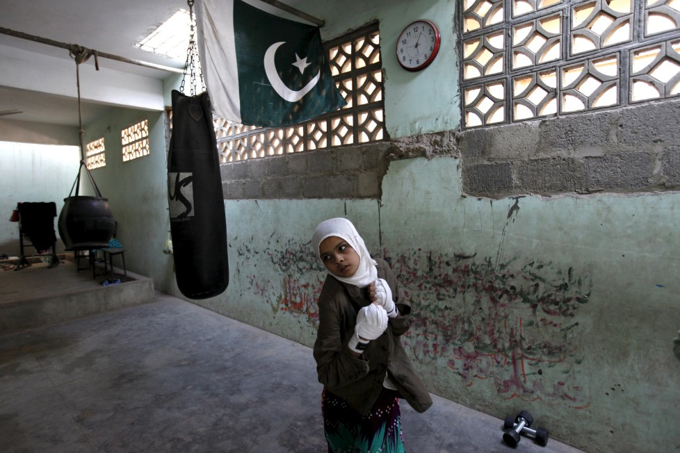 "REFILE - CLARIFYING NAME OF BOXING CLUBMehek, 15, who has her hands wrapped, takes part in an exercise session at the first women's boxing coaching camp in Karachi, Pakistan February 19, 2016. For the past six months about a dozen girls, aged 8 to 17, have gone to the Pak Shaheen Boxing Club after school to practice their jabs, hooks and upper cuts. Pakistani women have been training as boxers in small numbers and competed in the South Asian Games last year, said Younis Qambrani, the coach who founded the club in 1992 in the Karachi neighbourhood of Lyari, better known for internecine gang warfare than for breaking glass ceilings. REUTERS/Akhtar Soomro SEARCH ""THE WIDER IMAGE"" FOR ALL STORIES TPX IMAGES OF THE DAY"
