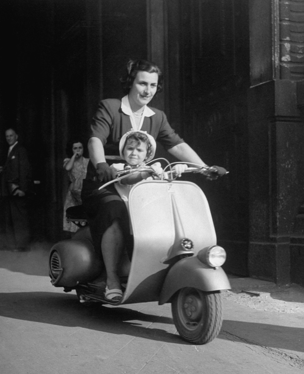 Mother and baby riding a Vespa scooter. (Photo by Dmitri Kessel/The LIFE Picture Collection/Getty Images)