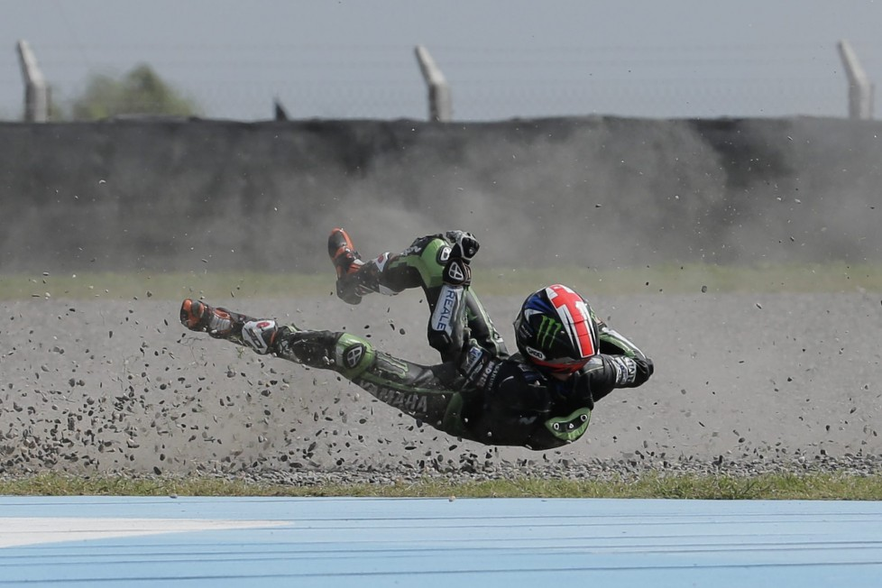 In this Saturday, April 2, 2016 photo, British rider Bradley Smith flies off his Yamaha after falling on Turn 1, during the Moto GP qualifying session at the Termas de Rio Hondo circuit, in Argentina. (AP Photo/Victor R. Caivano)